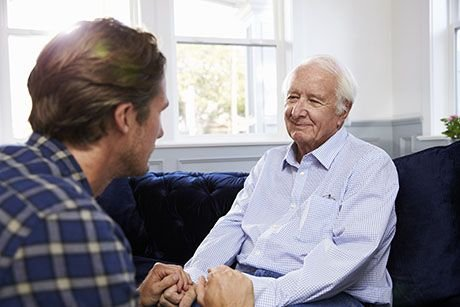 Adult_Son_Talking_To_Depressed_Father_At_Home-538047874.jpg
